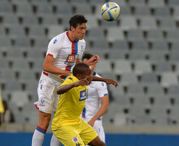 Martin Kelly of Crystal Palace battles for the ball with Lebogang Manyama of Supersport United during the 2015 Cape Town Cup Football Match between Supersport United and Crystal Palace at Cape Town Stadium, Cape Town, 24 July 2015