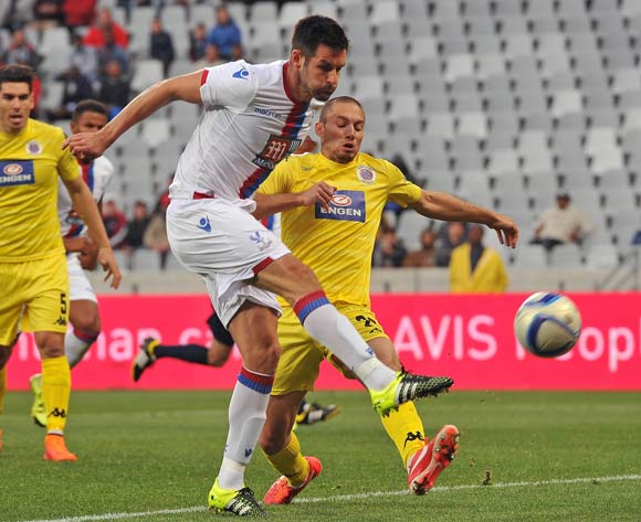 Scott Dann of Crystal Palace gets a shot away before a challenge from Roscoe Pietersen of Supersport United  during the 2015 Cape Town Cup Football Match between Supersport United and Crystal Palace at Cape Town Stadium, Cape Town, 24 July 2015