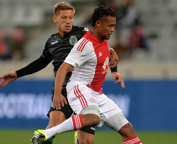 Granwald Scott of Ajax Cape Town evades challenge from Adrien Silva of Sporting Lisbon during the 2015 Cape Town Cup Football Match between Ajax Cape Town and Sporting Lisbon at Cape Town Stadium, Cape Town, 24 July 2015
