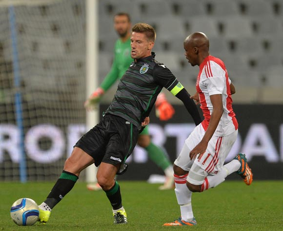 Adrien Silva of Sporting Lisbon evades challenge from Bantu Mzwakali of Ajax Cape Town during the 2015 Cape Town Cup Football Match between Ajax Cape Town and Sporting Lisbon at Cape Town Stadium, Cape Town, 24 July 2015