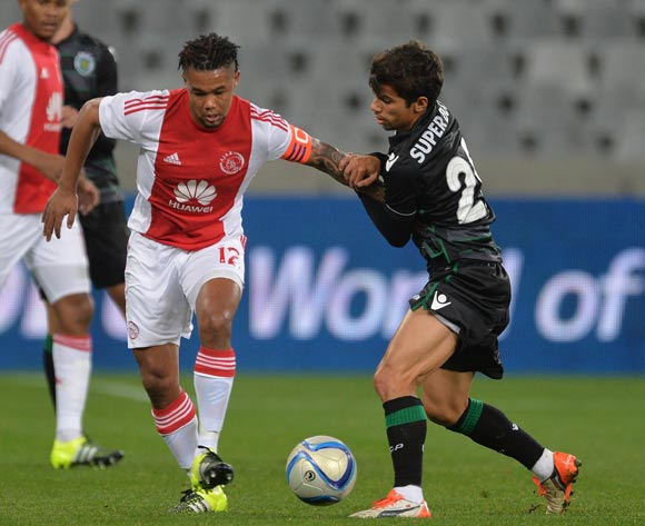 Granwald Scott of Ajax Cape Town battles for the ball with Andre Martins of Sporting Lisbon during the 2015 Cape Town Cup Football Match between Ajax Cape Town and Sporting Lisbon at Cape Town Stadium, Cape Town, 24 July 2015