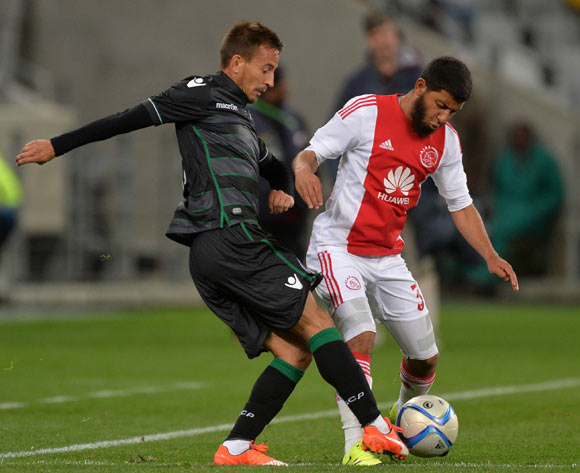 Joao Pereira of Sporting Lisbon battles for the ball with Riyaad Norodien of Ajax Cape Town during the 2015 Cape Town Cup Football Match between Ajax Cape Town and Sporting Lisbon at Cape Town Stadium, Cape Town, 24 July 2015