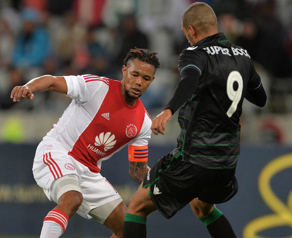 Granwald Scott of Ajax Cape Town gets past Islam Slimani of Sporting Lisbon during the 2015 Cape Town Cup Football Match between Ajax Cape Town and Sporting Lisbon at Cape Town Stadium, Cape Town, 24 July 2015
