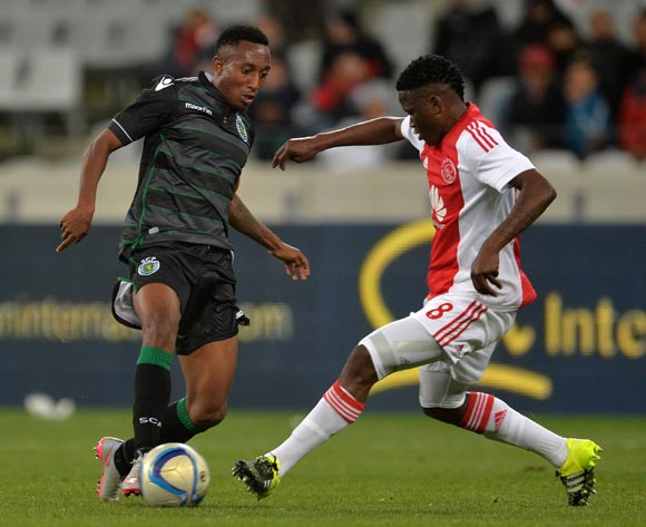 Gelson Martins of Sporting Lisbon evades challenge from Ndiviwe Mdabuka of Ajax Cape Town during the 2015 Cape Town Cup Football Match between Ajax Cape Town and Sporting Lisbon at Cape Town Stadium, Cape Town, 24 July 2015