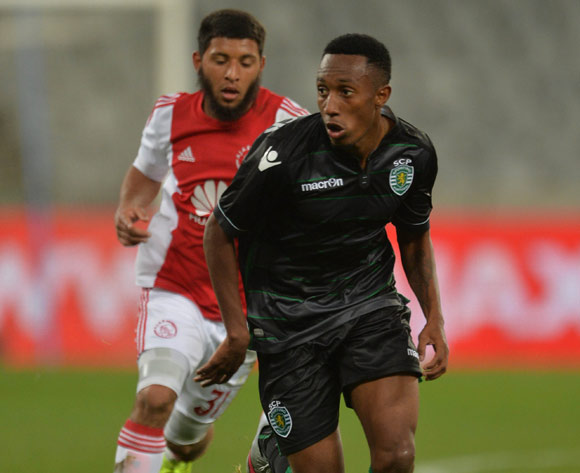 Gelson Martins of Sporting Lisbon evades challenge from Riyaad Norodien of Ajax Cape Town during the 2015 Cape Town Cup Football Match between Ajax Cape Town and Sporting Lisbon at Cape Town Stadium, Cape Town, 24 July 2015