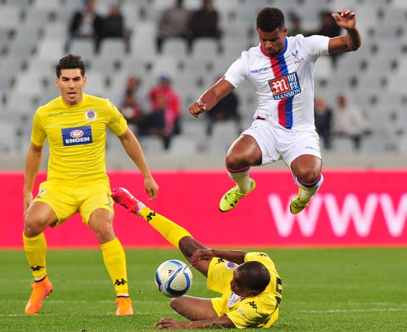 Fraizer Campbell of Crystal Palace takes evasive action as Lebogang Manyama of Supersport United slides in during the 2015 Cape Town Cup game between Supersport United and Crystal Palace at Cape Town Stadium, Cape Town on 24 July 2015
