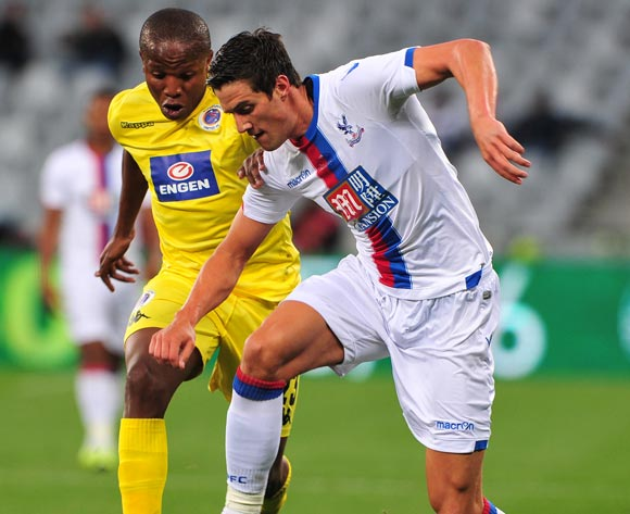 Martin Kelly of Crystal Palace and Lebogang Manyama of Supersport United battle for possession during the 2015 Cape Town Cup game between Supersport United and Crystal Palace at Cape Town Stadium, Cape Town on 24 July 2015