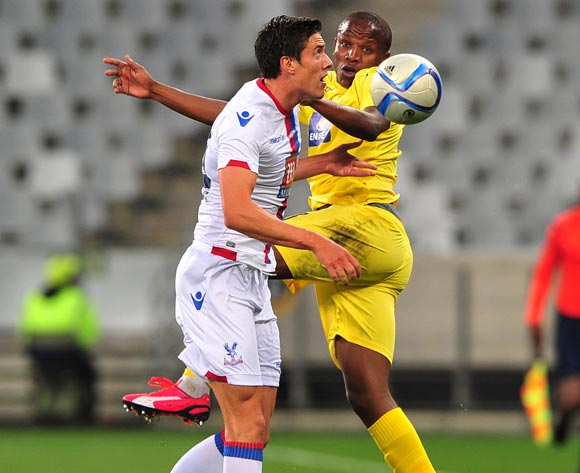 Lebogang Manyama of Supersport United beats Martin Kelly of Crystal Palace in the air during the 2015 Cape Town Cup game between Supersport United and Crystal Palace at Cape Town Stadium, Cape Town on 24 July 2015