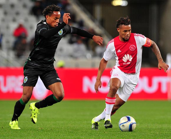 Granwald Scott of Ajax Cape Town turns away from Andre Carrillo of Sporting Lisbon during the 2015 Cape Town Cup game between Ajax Cape Town and Sporting Lisbon at Cape Town Stadium, Cape Town on 24 July 2015