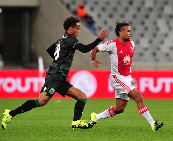 Granwald Scott of Ajax Cape Town gets his pass away under pressure from Andre Carrillo of Sporting Lisbon during the 2015 Cape Town Cup game between Ajax Cape Town and Sporting Lisbon at Cape Town Stadium, Cape Town on 24 July 2015