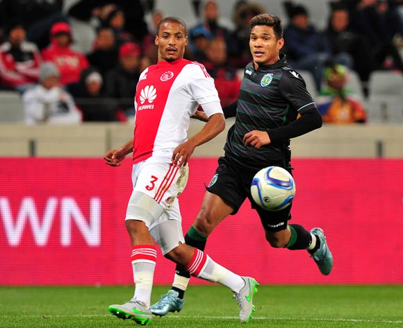 Rivaldo Coetzee of Ajax Cape Town gets the ball back to his keeper as Teofilo Gutierrez of Sporting Lisbon closes him down during the 2015 Cape Town Cup game between Ajax Cape Town and Sporting Lisbon at Cape Town Stadium, Cape Town on 24 July 2015